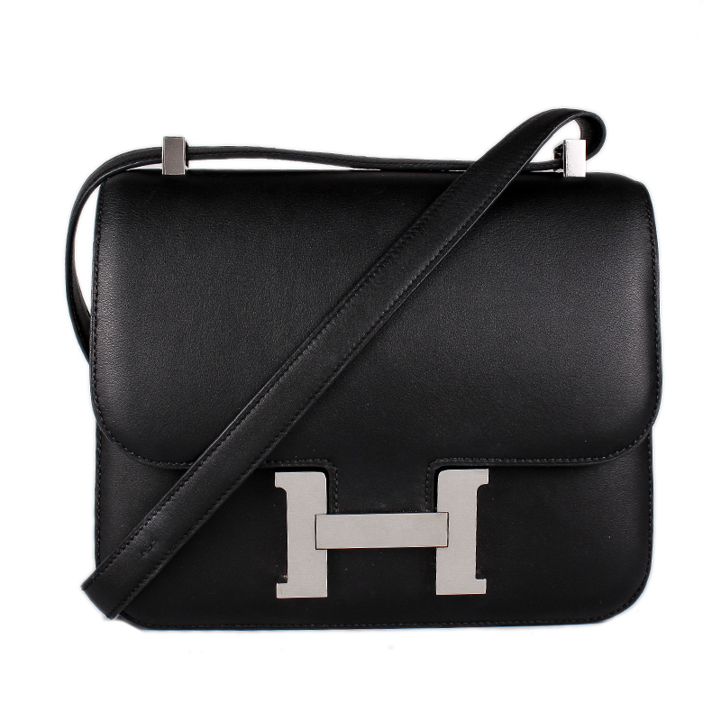 ffdc38205a79 We guarantee this is a genuine Hermès Black Noir Veau Swift leather Constance  24 with palladium-plated hardware