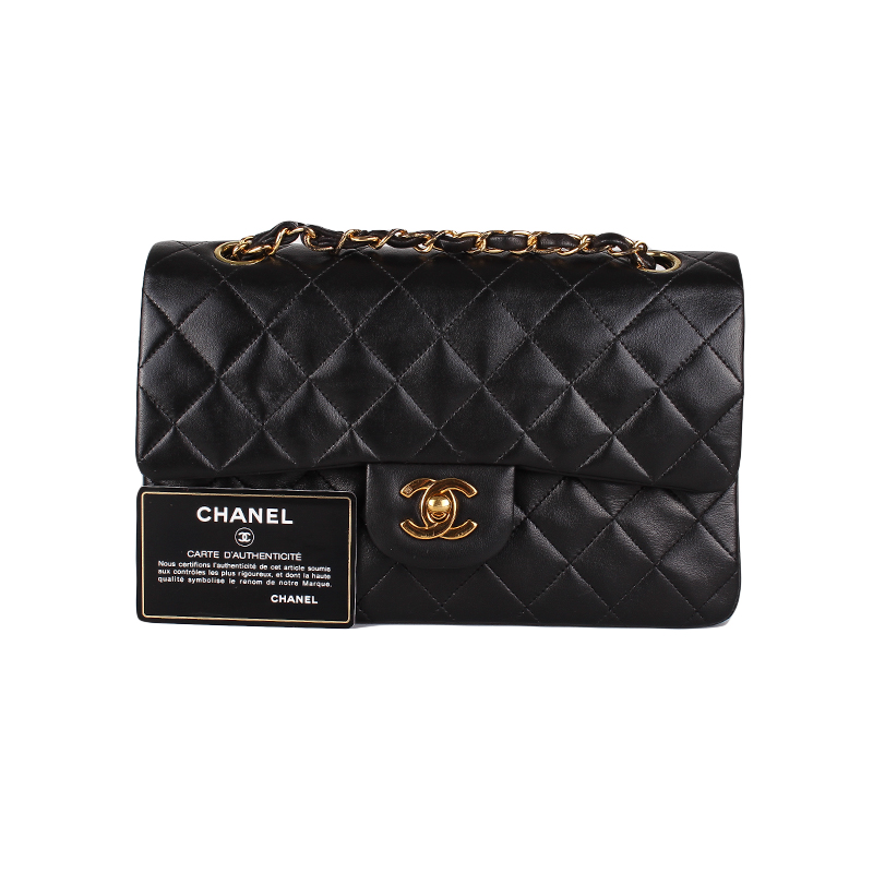 We guarantee this is a genuine Black quilted vintage lambskin leather Chanel  Classic Medium Double Flap bag with gold-tone hardware fcc63a5d0927c